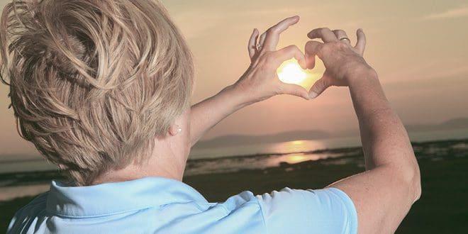 sun-through-heart-hands-w